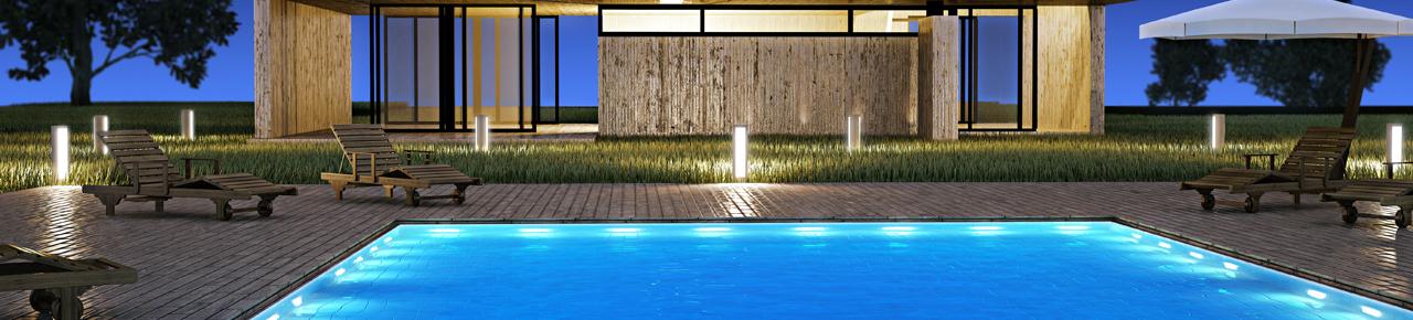 image montrant une maison d'architecte et une piscine de nuit